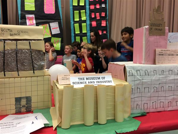 Students display Hyde Park at the Chicago World's Fair exhibit.