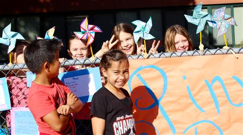 Westgate students display their pinwheels they made for Peace Day.