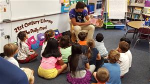 Lukas Pavlakis of Rolling Meadows High School, reads to the Westgate multi-age classroom.