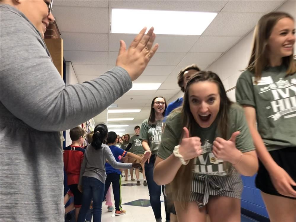 VIDEO: Over 30 seniors sent off to graduate with a high five and a few hugs at Ivy Hill