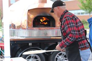 Fresh Pizza was made, on site, courtesy of Copper Oven Pizza.