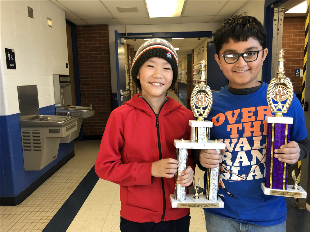 Pawn to E4! These two chess champions brought their trophy to Ivy.